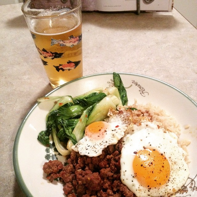 Korean rice bowl with spicy pork, Bol Chou, egg and a good beer. Yum!